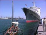 QE2 overshadows a traditional dhow at Dubai - 2001